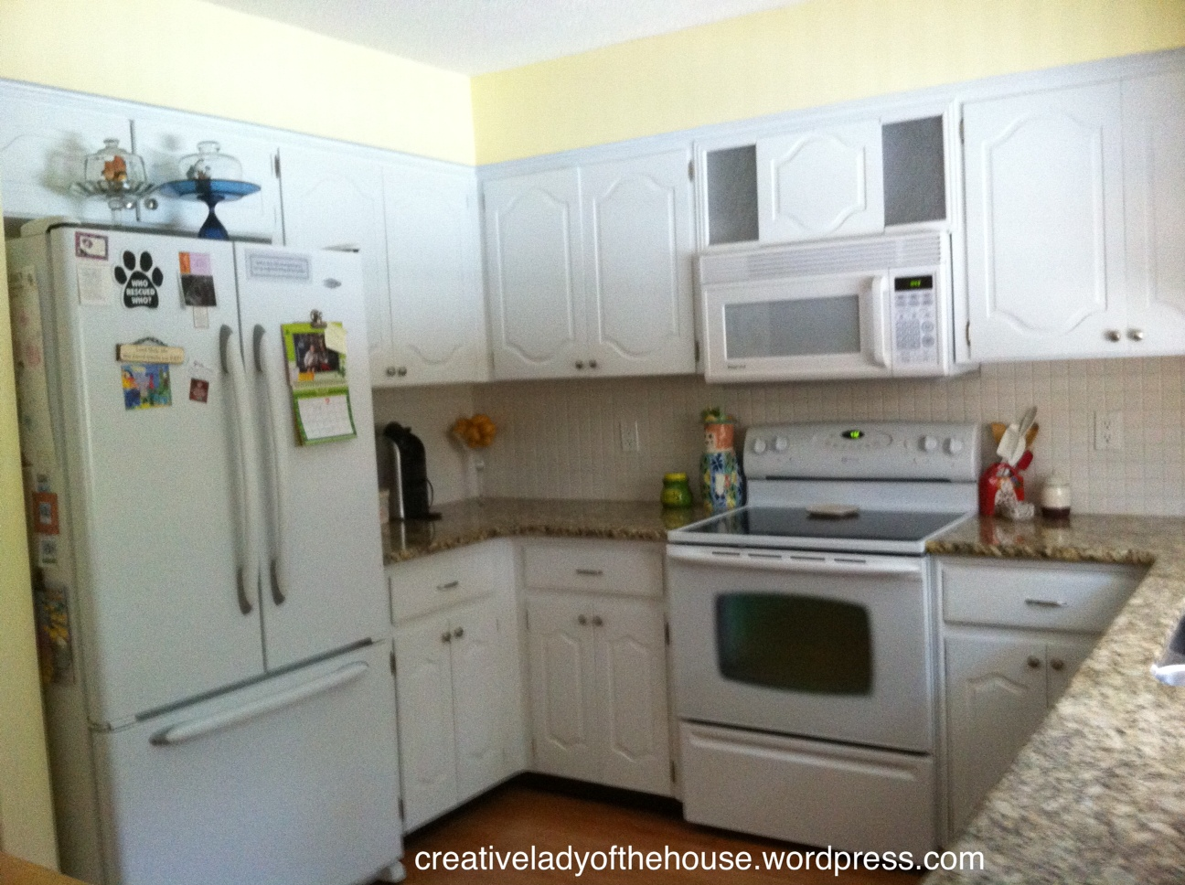 white fridge in kitchen. we just painted the cabinets white fridge in kitchen